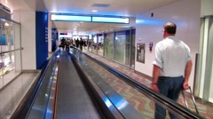 People on travelator in Dubai international airport Stock Footage