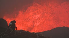 Extreme Climber Descends Into Violently Erupting Volcano Stock Footage