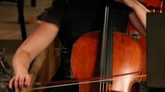 Close-up view on violoncello in orchestra - timelapse Stock Footage
