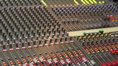 Controls of dj music mixer close-up Stock Footage