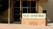 Stock Video Footage of Generic Police Department Sign and Entrance Zoom