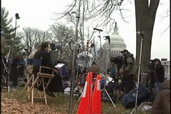 News crew outisde Supreme Court, US Capitol in background Stock Footage