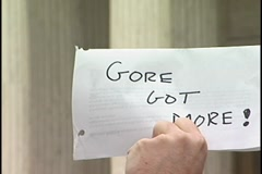 "Zoom in to ""Gore Got More"" hand written on paper at Supreme Court  protest. Stock Footage"