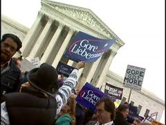Gore-Lieberman signs held high at Supreme Court protest Stock Footage