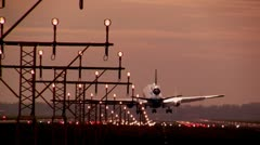 Huge plane lands in Beautiful light Stock Footage