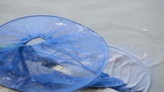 Catching fish by a fisherman using spinning reels on a lake in countryside Stock Footage