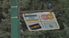 Credit Card Sign on Post Swinging in Wind Stock Footage