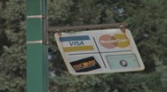 Stock Video Footage of Credit Card Sign on Post Swinging in Wind