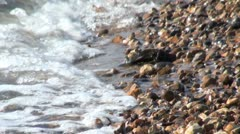 Waves Lapping Pebbly Beach Stock Footage