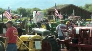 American flags and old tractors Stock Footage