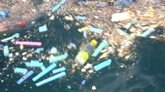 Floating garbage - stock footage
