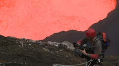 Climber Stands Perilously Close To Violently Erupting Volcano Stock Footage