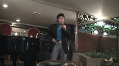 Elvis impersonator in Thailand - stock footage