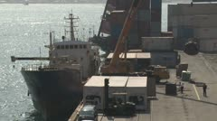 Crane Loads Cargo Onto Ship At Port Stock Footage