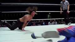 Pro wrestling - spectacular 450 degree front flip off top rope - stock footage