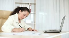 Business woman working with documents near laptop. DOLLY HD Stock Footage
