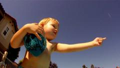 Young boy giving direction football poolside swimming pool underwater shot Stock Footage