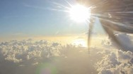 Flying into the clouds in sunset Stock Footage