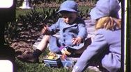 Stock Video Footage of Brother and Sister in Garden Circa 1950 (Vintage Film Home Movie) 1141