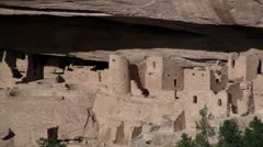 Pan across ancient American Indian dwellings at Mesa Verde, Colorado. - stock footage