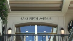 Stock Video Footage of WorldClips-Saks Fifth Ave Sign-zooms