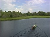 WorldClips-Jungle Lake Boat-ws Stock Footage