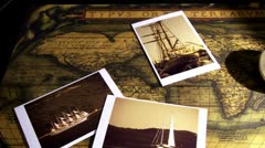 Golden compass and old maps - pan right Stock Footage