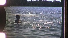 Boys Diving in Summer Lake Dive Swim 1960s Vintage Film Home Movie Footage 1168 Stock Footage