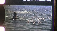 Stock Video Footage of Boys Diving in Summer Lake 1960s Vintage Film Home Movie Footage 1168