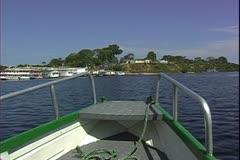 WorldClips-River Boat Arrives Village Stock Footage