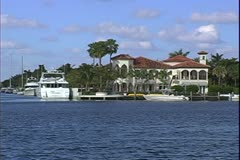 WorldClips-Canal House & Yacht Stock Footage