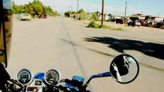POV Lone Motorcycle Rider In Desert Town- Bombay Beach CA Stock Footage