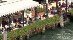 WorldClips-Canal Cafe Waiter-overhead-ws Stock Footage