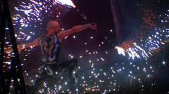Man dancing with pyro, sparks explosions/fireworks HD - stock footage