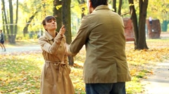 Young couple having fight in autumn park, slow motion HD - stock footage