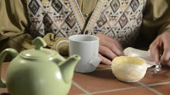 Trembling hands making tea 1 Stock Footage