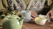 Stock Video Footage of trembling hands making tea 1