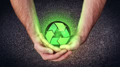 Hands holding a recycling symbol animating videos Stock Footage