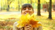 Stock Video Footage of Young happy woman with maple golden leaves in beautiful autumn park HD