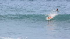 Surfer riding at the ocean big wave Stock Footage