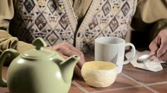 Trembling hands making tea 2 Stock Footage
