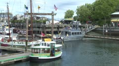WorldClips-Victoria Harbour Ferry Boards-pan Stock Footage