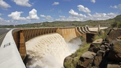 Time lapse of a big dam with strong flowing water from open sluice gates Stock Footage