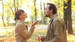 Young couple having fight in autumn park, slow motion - stock footage