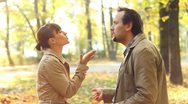 Young couple having fight in autumn park, slow motion Stock Footage