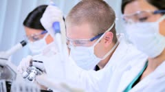 Junior Doctors Working in Hospital Laboratory - stock footage