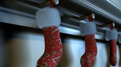Christmas stockings hanging on the hearth Stock Footage