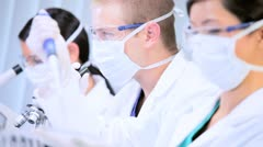 Three Junior Doctors Studying in Hospital Laboratory - stock footage