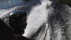 Waves and spray behind a motorboat. Slow-motion pictures. Stock Footage
