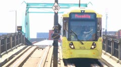 Metrolink Tram off Bridge Ramp Stock Footage